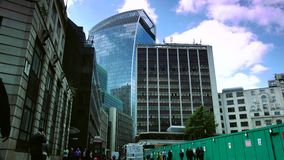 ULTRA HD 4k, real time, Traffic and pedestrians on City, modern building in London,. LONDON, UK - circa 2015: Traffic and pedestrians on City, modern building in stock video