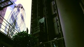 ULTRA HD 4k, real time, Traffic and pedestrians Lloyd and Gherkin square building,in London,. LONDON, UK - circa 2015: Traffic and pedestrians Lloyd and Gherkin stock video