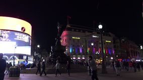 ULTRA HD 4k, real time, Traffic and pedestrians on Piccadilly Circus in the evening. LONDON, UK - April 15: Traffic and pedestrians on Piccadilly Circus in the stock video footage