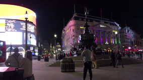 ULTRA HD 4k, real time, Traffic and pedestrians on Piccadilly Circus in the evening. LONDON, UK - April 15: Traffic and pedestrians on Piccadilly Circus in the stock footage