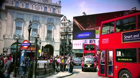 ULTRA HD 4k, real time, Traffic and pedestrians on Piccadilly Circus in a sunny day stock video