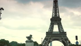 ULTRA HD 4K, real time, zoom; Car traffic in Paris under Eiffel tower, d'Iena Seine bridge,. PARIS, FRANCE - June 27, 2015 Car traffic in Paris under Eiffel stock video footage