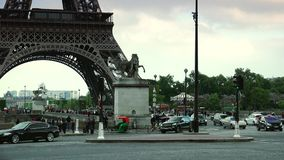 ULTRA HD 4K, real time, zoom; Car traffic in Paris under Eiffel tower, d'Iena Seine bridge,. PARIS, FRANCE - June 27, 2015 Car traffic in Paris under Eiffel stock footage