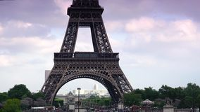 ULTRA HD 4K, real time, zoom; Car traffic in Paris under Eiffel tower, d'Iena Seine bridge,. PARIS, FRANCE - June 27, 2015 Car traffic in Paris under Eiffel stock video