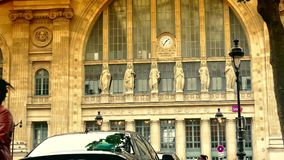 ULTRA HD 4K, real time, zoom; exterior of Gare du Nord railway stations in Paris and the street life. PARIS, FRANCE - JUNE 21, 2015: Gare du Nord (North Station stock video footage