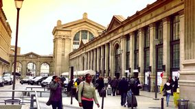 ULTRA HD 4K, real time, zoom; exterior of Gare du Nord railway stations in Paris and the street life. PARIS, FRANCE - JUNE 21, 2015: Gare du Nord (North Station stock video