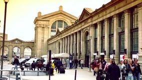 ULTRA HD 4K, real time, zoom; exterior of Gare du Nord railway stations in Paris and the street life. PARIS, FRANCE - JUNE 21, 2015: Gare du Nord (North Station stock footage