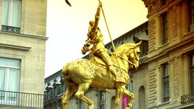 ULTRA HD 4K, real time, zoom,Gilded bronze equestrian statue depicting Saint Jeanne d Arc (Joan of Arc). Place des Pyramides, stock video footage