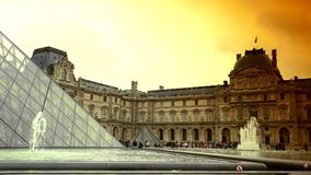 ULTRA HD 4K, real time, zoom, People walking in front of the Louvre Museum and the Pyramid. PARIS, FRANCE - MAY 7, 2015: People walking in front of the Louvre stock footage