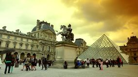 ULTRA HD 4K, real time, zoom, People walking in front of the Louvre Museum and the Pyramid. PARIS, FRANCE - MAY 7, 2015: People walking in front of the Louvre stock video