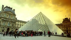 ULTRA HD 4K, real time, zoom, People walking in front of the Louvre Museum and the Pyramid. PARIS, FRANCE - MAY 7, 2015: People walking in front of the Louvre stock video footage