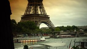 ULTRA HD 4K, real time, zoom; Tourists Visit in Tour Boats on Seine River with Iconic Eiffel Tower in Paris. PARIS, FRANCE - circa 2015 Iconic Eiffel Tower stock video footage