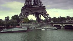 ULTRA HD 4K, real time, zoom; Tourists Visit in Tour Boats on Seine River with Iconic Eiffel Tower in Paris. PARIS, FRANCE - circa 2015 Iconic Eiffel Tower stock video