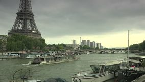 ULTRA HD 4K, real time, zoom; Tourists Visit in Tour Boats on Seine River with Iconic Eiffel Tower in Paris. PARIS, FRANCE - circa 2015 Iconic Eiffel Tower stock footage