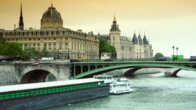 ULTRA HD 4K, real time, zooming; Conciergerie and famous bridge on the Seine river stock video footage