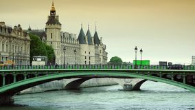 ULTRA HD 4K, real time, zooming; Conciergerie and famous bridge on the Seine river stock footage