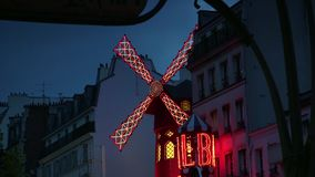 ULTRA HD 4K, real time, zooming; The Moulin Rouge by night,. PARIS - circa 2015: The Moulin Rouge by night, on May in Paris, France. Moulin Rouge is a famous stock video
