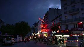 ULTRA HD 4K, real time, zooming; The Moulin Rouge by night,. PARIS - circa 2015: The Moulin Rouge by night, on May in Paris, France. Moulin Rouge is a famous stock video footage