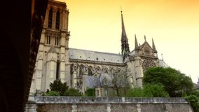 ULTRA HD 4K, real time, zooming; Notre-Dame is one of the most famous landmarks of Paris. PARIS, FRANCE - circa 2015: Notre Dame Cathedral and Seine River stock video footage