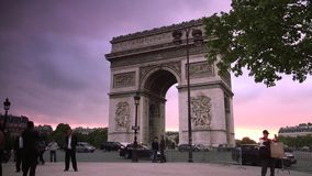 ULTRA HD 4K, real time, zooming; sunset with the Arc de Triomphe with traffic cars. Paris, France - circa 2015: Traffic drives along the Champs-Elysees at sunset stock video
