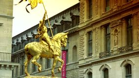 ULTRA HD 4K, zoom,Gilded bronze equestrian statue depicting Saint Jeanne d Arc (Joan of Arc). Place des Pyramides, stock video footage