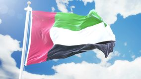 Realistic flag of United Arab Emirates waving against time-lapse clouds background. Seamless loop in 4K resolution with stock footage