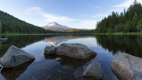 Ultra High Definition 4k Time Lapse of Moving White Clouds and Blue Sky Over Mount Hood and Trillium Lake in Oregon stock footage