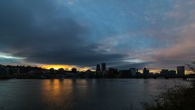 Time lapse of clouds over Portland OR city along at colorful sunset 4k uhd. Ultra high definition 4k time lapse video of moving clouds and sky over Portland OR stock footage
