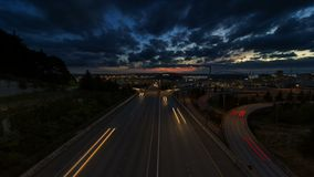 Ultra High Definition UHD 4k Time Lapse Movie of Long Exposure Freeway Traffic Over Cityscape of Seattle Washington at Sunset. Ultra High Definition UHD 4k Time stock video footage