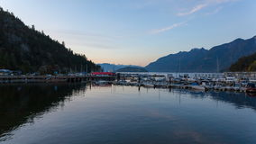Ultra High Definition UHD 4k Time Lapse Movie of Moving Clouds with Water Reflection at Sunset in Horseshoe Bay BC 4096x2304 stock video footage