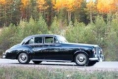 Ultra luxury vintage retro car. On wood road Stock Photo