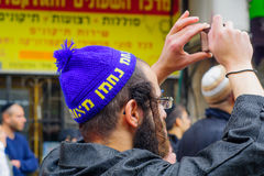 Ultra-orthodox Jewish men, in Mea Shearim, Jerusalem Stock Photo
