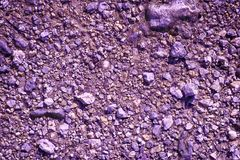 Ultra purple Ground like on Mars, land texture, sand surface, stone background.  stock photos
