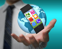 Ultra slim smartwatch on globe in male hand Stock Photo