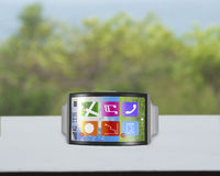 Ultra-thin bent interface smartwatch horizontal with metal watch Stock Photography