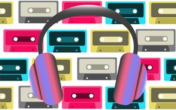 Ultra-violet big fashionable full-sized headphones for listening to music on the background of old retro vintage hipster audio cas. Settes from the 80`s, 90`s Royalty Free Stock Photos