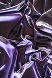 Ultra violet crumpled shiny silk. Fabric background royalty free stock photography