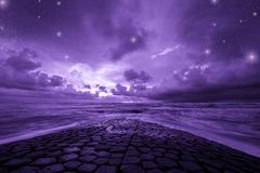 Ultra violet fantasy background, ocean with fantastic night sky, color of the year 2018. Ultra violet fantasy background, road to the ocean with fantastic night royalty free stock photo