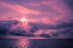 Ultra-violet seascape with clouds royalty free stock images