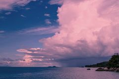 Ultra-violet storm clouds over the ocean royalty free stock photography