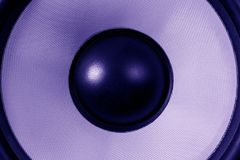 Ultra violet Subwoofer dynamic or sound speaker, party background, dark purple toned stock image