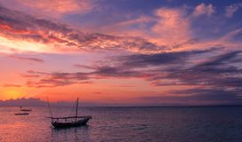 Ultra violet sunset with fishing dhow Royalty Free Stock Images