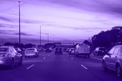Ultra violet traffic, cars on highway road on evening night in busy city Royalty Free Stock Photos