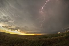 Supercell rotating thunderstorm at sunset with lightning bolt over Colorado royalty free stock photos