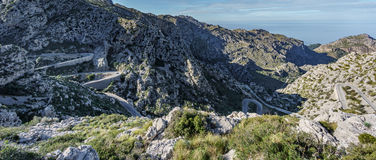 Ultra wide angle view of mountain hairpin bend curved road Royalty Free Stock Images