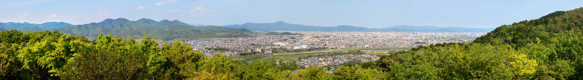Ultra wide panorama of Arashiyama and Kyoto city in Japan and the surrounding landscape and mountains Royalty Free Stock Photo