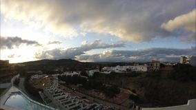 Ultra wide time lapse of cloudy sky. Ultra wide time lapse showing a sunset in San Enrique de Guadiaro, Spain stock video footage