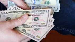 UltraHD video of counting money stock footage