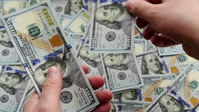 UltraHD video of counting money stock video footage