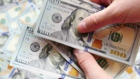 UltraHDvideo van het tellen van geld stock footage